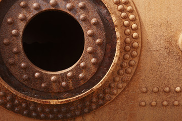 Rusted old engine. Circular form.