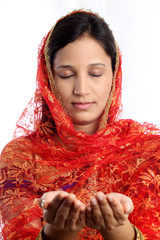 Portrait of a young muslim woman praying