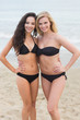 Smiling young bikini women at the beach