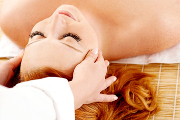 Female getting a head massage