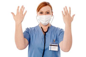 Female surgeon raising her arms
