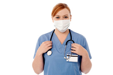 Female surgeon wearing face mask