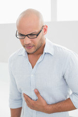 Casual man suffering from chest pain at home