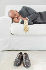 Elegant businessman sleeping on sofa