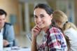 Cheerful young woman at university