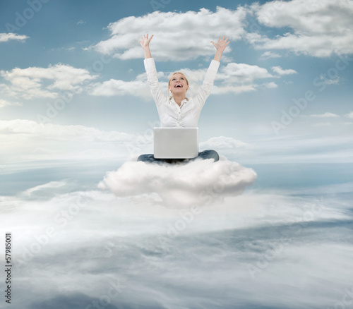 Reauccessful  businesswoman with laptop on the cloud