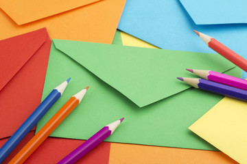 colorful envelopes and pencils