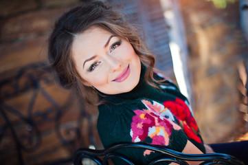portrait of a beautiful girl in a black sweater