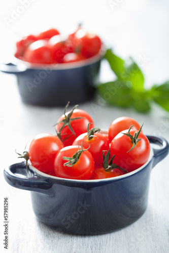 cherry tomatoes and basil in casserole