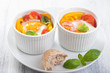 baked eggs with tomatoes and paprika