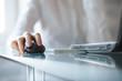 Leinwanddruck Bild - Businesswoman clicking on cordless mouse
