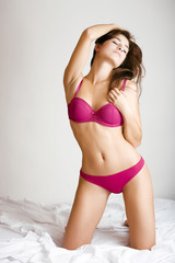 beauty brunette woman in pink lingerie