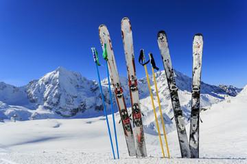 Ski, winter season - ski equipments on ski run