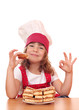 little girl cook with ok hand sign and apple cakes