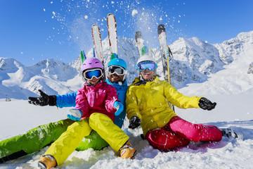 Ski and fun - family enjoying winter holiday
