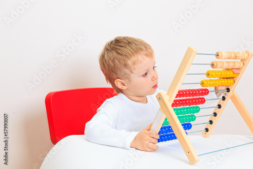 little boy playing with abacus, early learning