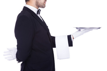 Waiter holding an empty silver tray, isolated on a white backgro
