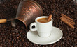 Turkish coffe pot with cup of coffe