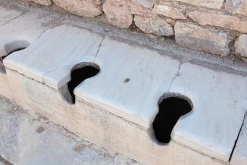 Communal Roman toilets Ephesus Turkey