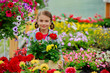 Gardening - girl holding flowers in garden center