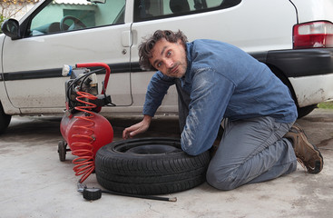 funny man changing tire