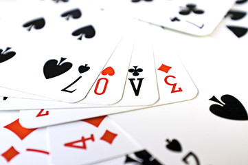 Word LOVE made ​​with playing cards color image