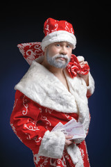 Portrait of Santa, who holds the money on a blue background