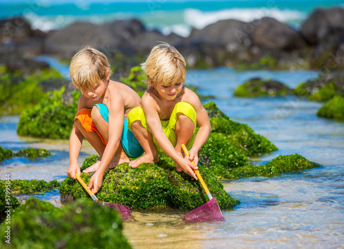 Two young boys having fun on tropcial beach