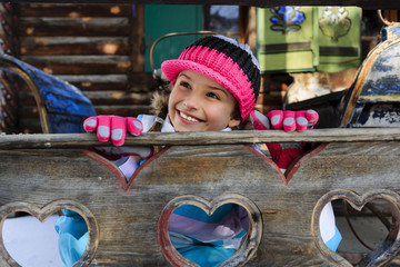 Winter - young girl enjoying winter holiday