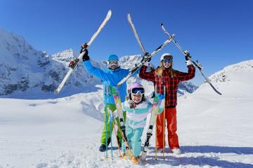 Ski and fun - family enyoing winter holiday