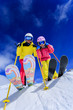Ski and fun - skiers enjoying ski holiday - 57996845