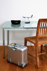 Airline pilot's desk with hat and suitcase
