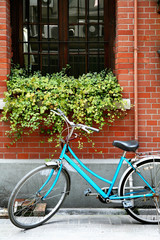 Bicycle parked outside of building