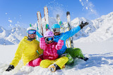 Ski, sun and fun - family enjoying winter holiday