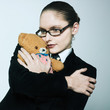 business woman huging teddy bear
