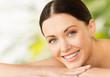 beautiful smiling woman in spa salon