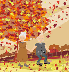 Senior couple walking in autumn day