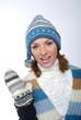 canvas print picture - Sprechende junge Frau mit Winterkleidung