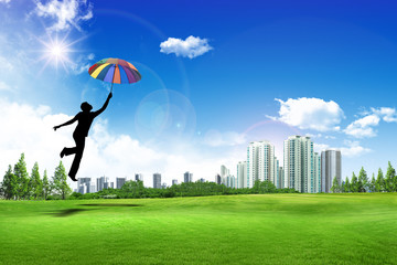 man jumping with umbrella