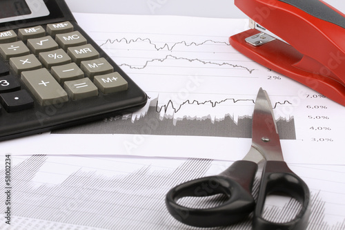 Business still-life of a scissors, stapler, calculator