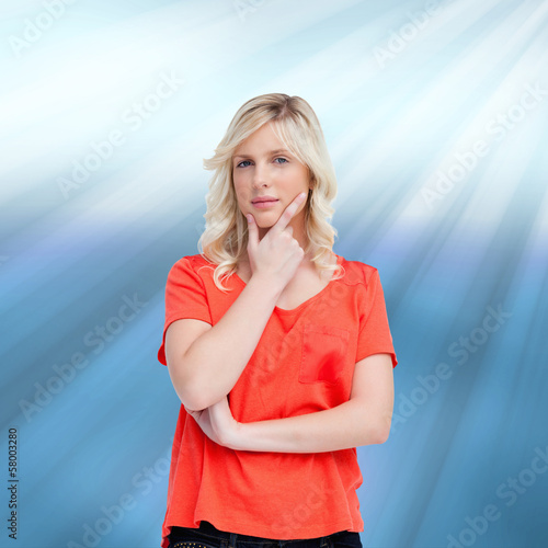 Composite image of teenager standing upright thoughtfully with h