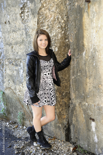 Happy Teen by Crumbling Wall