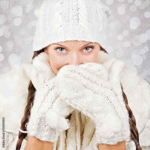 Cute young woman wearing white hat and gloves