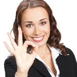 Businesswoman with okay gesture, isolated