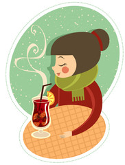 Girl enjoying hot wine in winter cafe