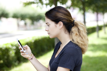 Woman reading a message on the phone