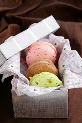 French multicolored macaroons in a gift box sweet present