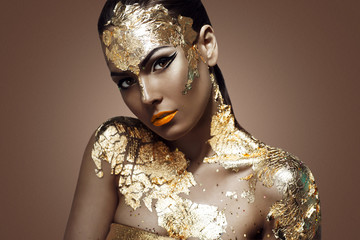 beautiful woman and gold.