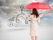 Composite image of businesswoman holding umbrella