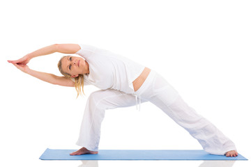mid age woman doing yoga exercises